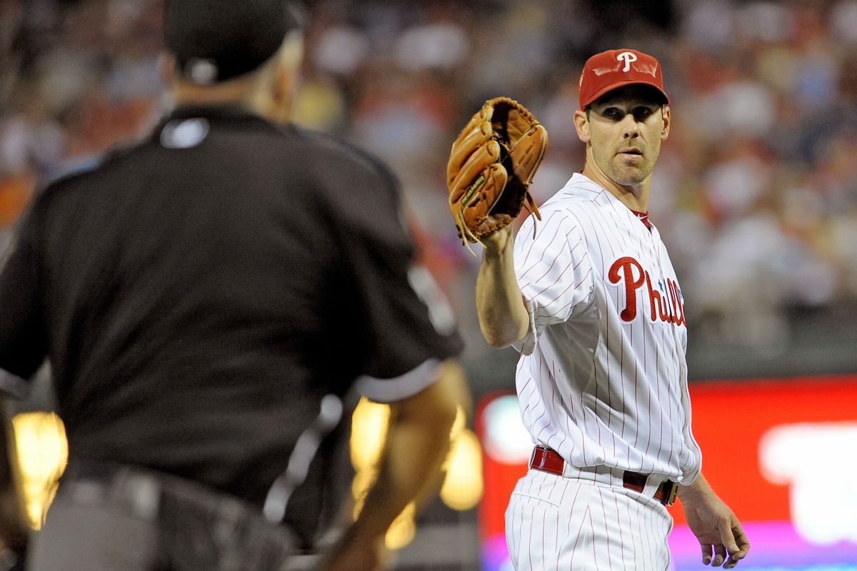Is Cliff Lee catching a baseball or waving goodbye? YOU BE THE JUDGE. Mandatory Credit: Eric Hartline-US PRESSWIRE