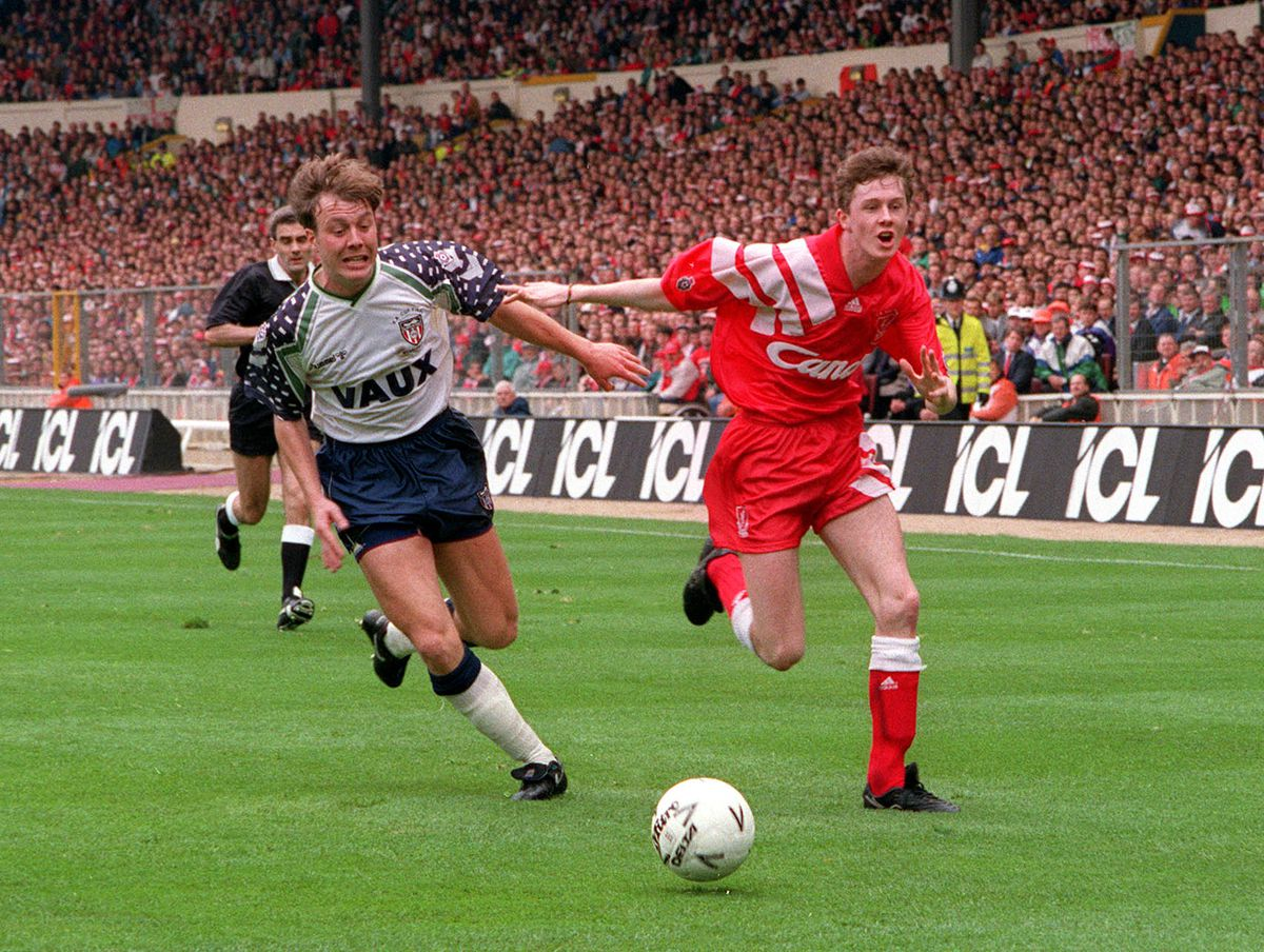 Football. 1992 FA Cup Final. Wembley. 9th May, 1992. Liverpool 2 v Sunderland 0. Liverpool's Steve McManaman is challenged for the ball by Sunderland's Gary Owers.