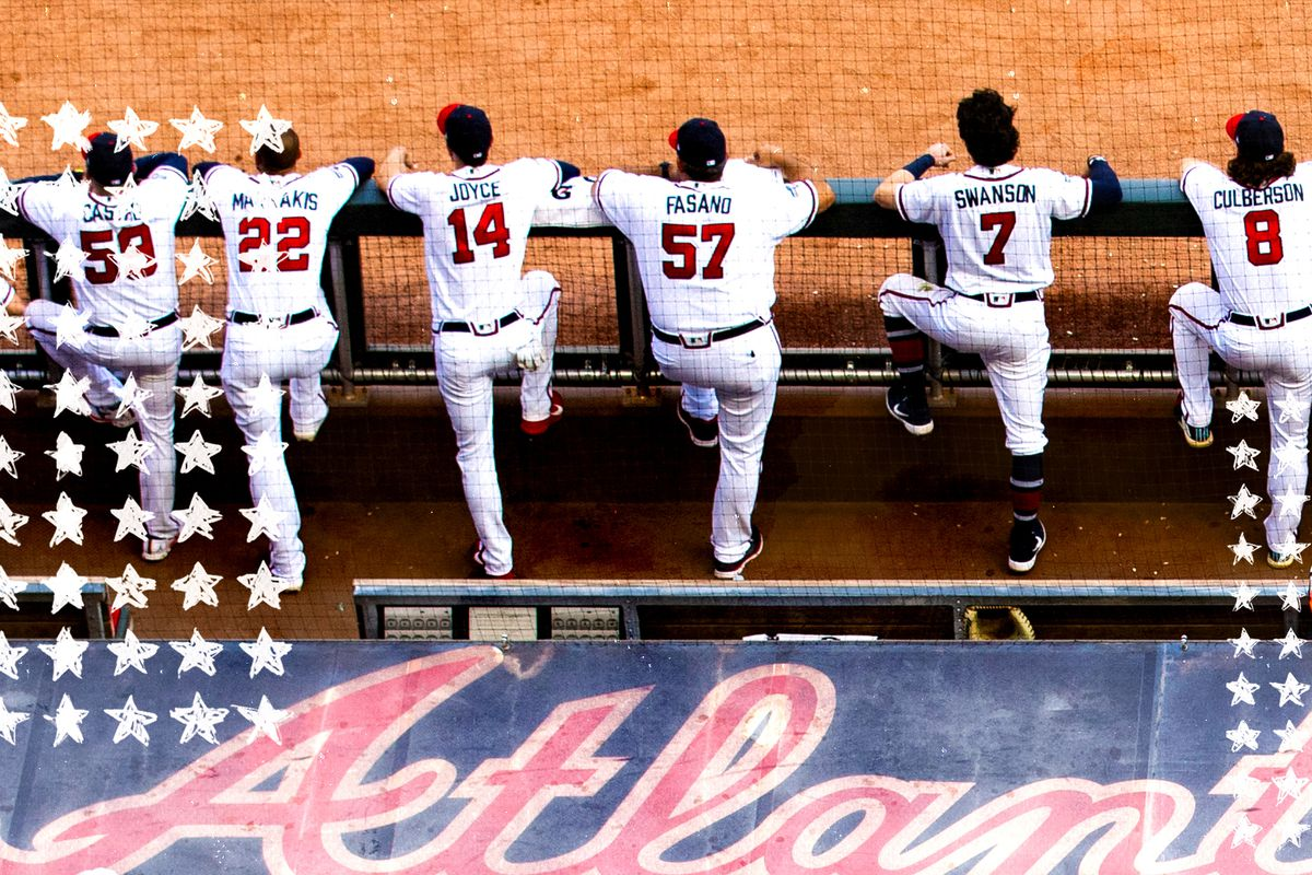 An overhead shot of the Atlanta Braves dugout and several teammates during Game Five of the National League Division Series against the St. Louis Cardinals at SunTrust Park on October 9, 2019 in Atlanta, Georgia.