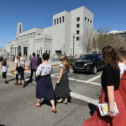 Sister missionaries walk near the Conference Center during the 191st Annual General Conference of The Church of Jesus Christ of Latter-day Saints in Salt Lake City on Saturday, April 3, 2021.