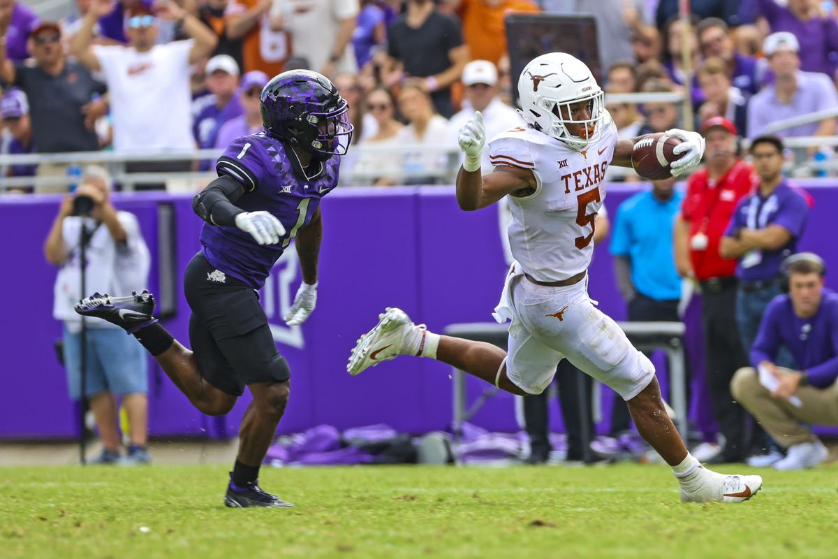 Texas Longhorns running back Bijan Robinson (5) runs with the ball as TCU Horned Frogs cornerback Tre'Vius Hodges-Tomlinson (1) chases during the second half at Amon G. Carter Stadium.