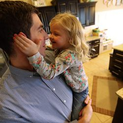 Millie Widdison, 4, hugs her father Kyle Widdison at home in Saratoga Springs, Utah, Friday, Jan. 8, 2016.
