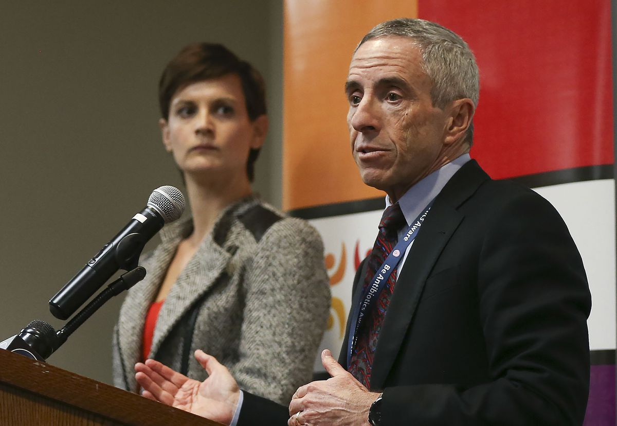Dr. Angela Dunn, state epidemiologist, left, listens as Dr. Andrew Pavia, chief of the Division of Pediatric Infectious Diseases at University of Utah Health, speaks about new developments with the novel coronavirus COVID-19 and how the state's health systems and hospitals are working together to prepare for possible community spread of the illness during a press conference at the Utah Department of Health in Salt Lake City on Thursday, Feb. 27, 2020.