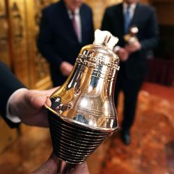 Rabbi Meir Y. Soloveichik holds a Liberty Bell Torah adornment as he leads a tour for President M. Russell Ballard, acting president of the Quorum of the Twelve Apostles, and Elder Jack N. Gerard, General Authority Seventy, of The Church of Jesus Christ of Latter-day Saints, at the Spanish and Portuguese Synagogue of the Congregation Shearith Israel in New York City on Friday, Nov. 15, 2019.