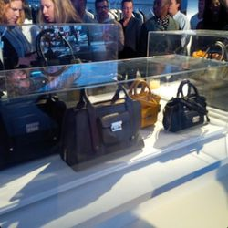 """So you consider breaking into this <a href=""""https://twitter.com/lizlange/status/375807235378925568"""">glass case</a>, which is far to demure for this event anyway, and grab the bag that'll fit your laptop. You thankfully see a scarf someone unwittingly drop"""