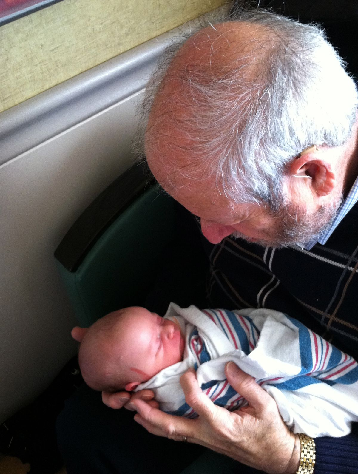 The author's father meets his new grandson