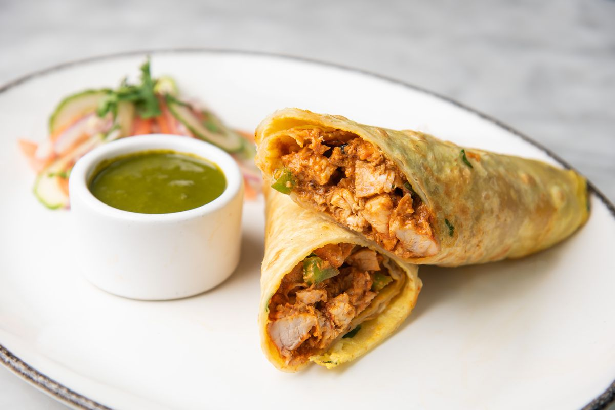A chicken kathi roll with mint cilantro chutney will be at the new Bindaas location