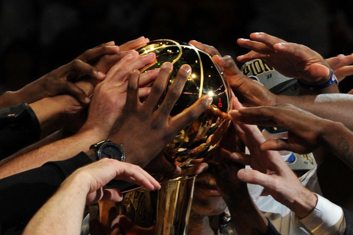 The Dallas Mavericks celebrate defeating