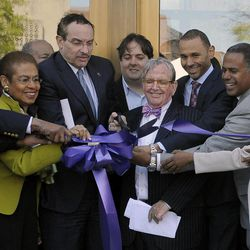 In this photo taken April 9, 2012, council member Marion Barry,  D.C. Delegate to Congress, Eleanor Holmes-Norton, Mayor Vincent Gray, council member Jim Graham, Malik and Chip Ellis of Ellis Development, Myla Moss, ANC Comm., cut the ribbon during the official opening at the Howard Theatre in Washington.