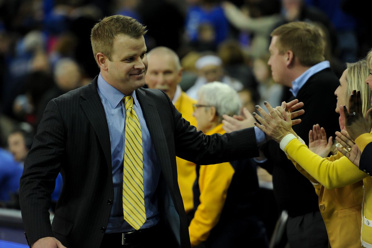 The head coach with the best recruiting class in the Big East high fiving his supporters.