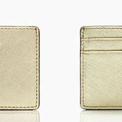 The <b>Kate Spade</b> Cedar Street Card Holder has us seeing gold and is perfect for when you don't need to carry a lot. This thin card holder is made in crosshatched leather and features 14-karat light gold plated hardware. There are two card slots on th