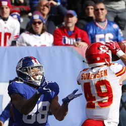 New York Giants tight end Evan Engram (88) reacts as Kansas City Chiefs strong safety Daniel Sorensen (49) intercepts a pass to him during the first half of an NFL football game Sunday, Nov. 19, 2017, in East Rutherford, N.J. (AP Photo/Kathy Willens)