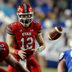Utah Utes quarterback Charlie Brewer (12) takes a snap as BYU and Utah play an NCAA football game at LaVell Edwards Stadium in Provo on Saturday, Sept. 11, 2021. BYU won 26-17, ending a nine-game losing streak to the Utes.