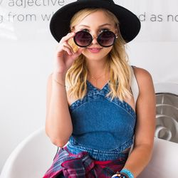 Olivia Holt in an ASOS romper, Cotton On plaid shirt, and Perverse sunglasses.