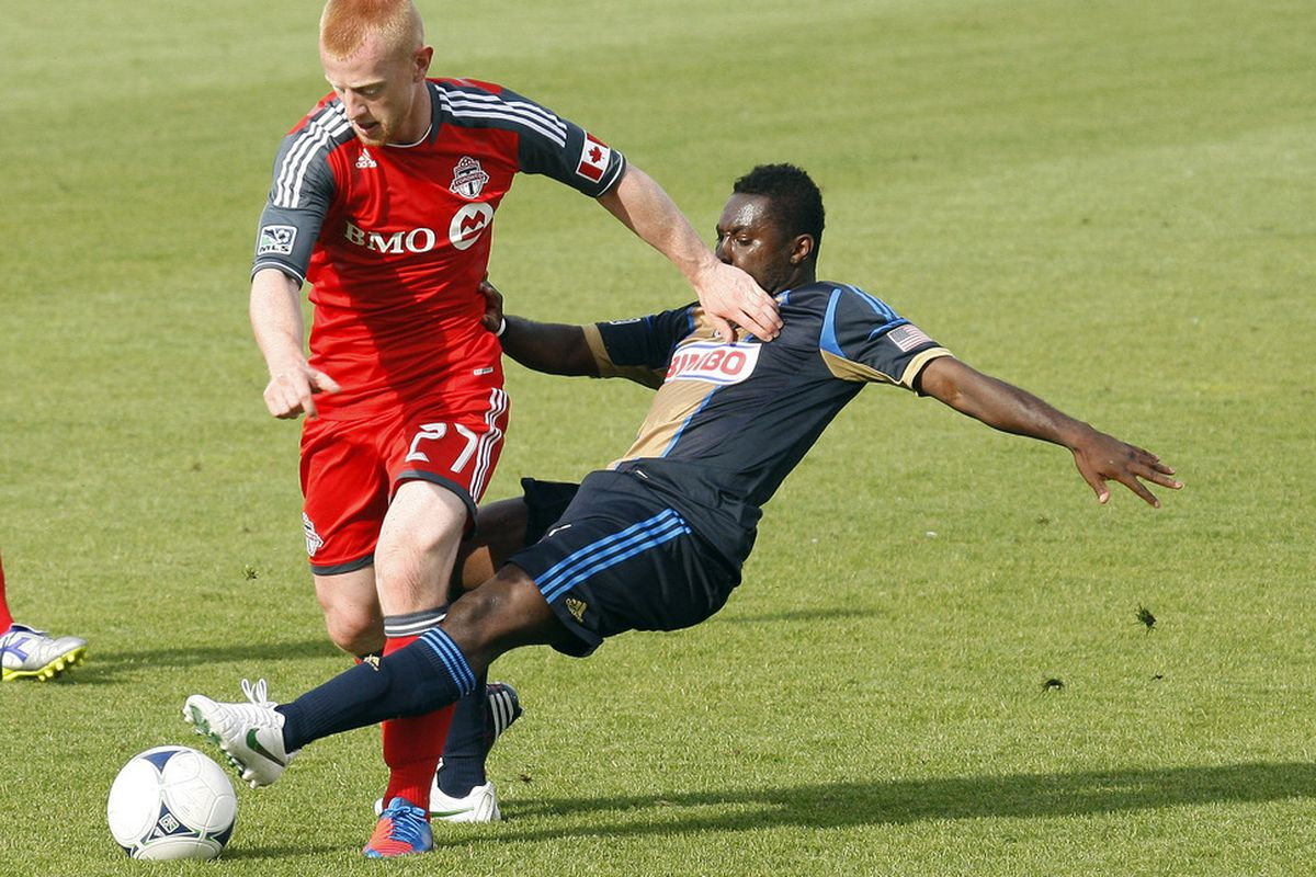 TORONTO, CANADA - MAY 26: Richard Eckersley #27 of Toronto FC battles for the ball against  Freddy Adu #11 of the Philadelphia Union during MLS action at BMO Field May 26, 2012 in Toronto, Ontario, Canada.  (Photo by Abelimages/Getty Images)