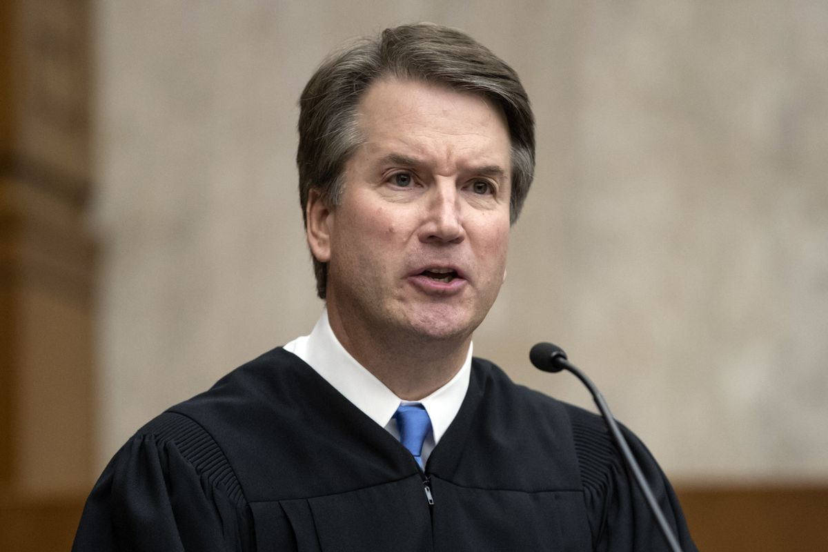 In this Aug. 7, 2018, photo, President Donald Trump's Supreme Court nominee, Judge Brett Kavanaugh, officiates at the swearing-in of Judge Britt Grant to take a seat on the U.S. Court of Appeals for the Eleventh Circuit at the U.S. District Courthouse in