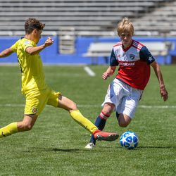 Thomas Roberts (23) dribbling during the opening match of the 40th Annual Dallas Cup.