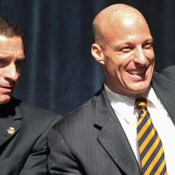 FILE - In this March 29, 2012 file photo, new Illinois men's basketball coach John Groce, right, laughs alongside athletic director Mike Thomas during Groce's introductory news conference in Champaign, Ill. Groce says he hasn't decided how he'll deal with the loss of 7-1 center Meyers Leonard to the NBA draft but says he doesn't want to add a player to his roster just to plug a hole.