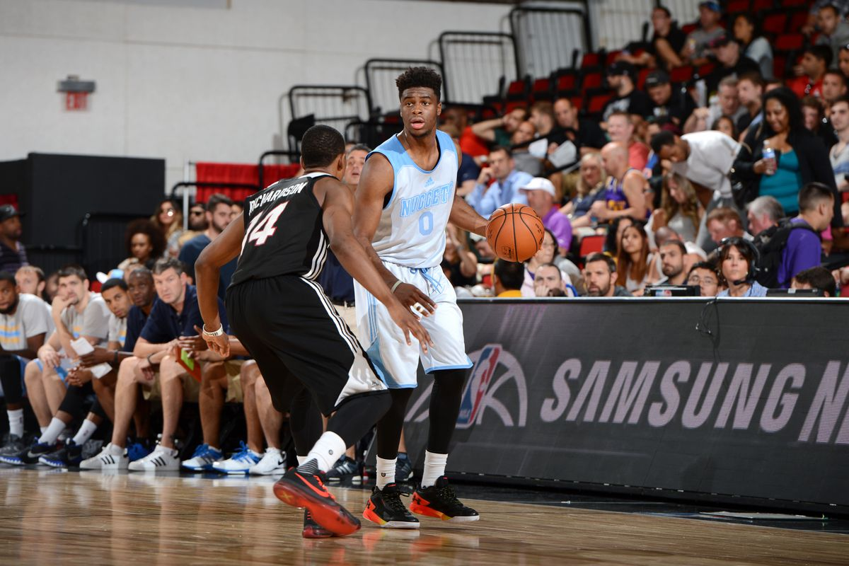 Emmanuel Mudiay surveying the field agains the Miami Heat