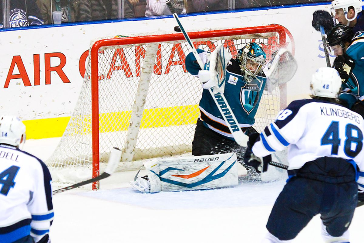 Worcester Sharks goaltender Harri Sateri makes one of his 30 saves against the St. John's IceCaps Tuesday night at the Mile One Centre.
