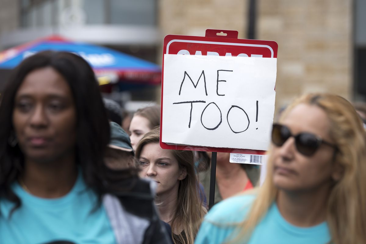 Protesters attend a Me Too rally in Los Angeles, California on November 12, 2017