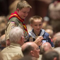 A couple of scouts pose for a photo prior to the start of the celebration. Thousands of scouts and their leaders assemble Tuesday, Oct. 29, 2013 in the Conference Center in Salt Lake City to celebrate a century of honor.
