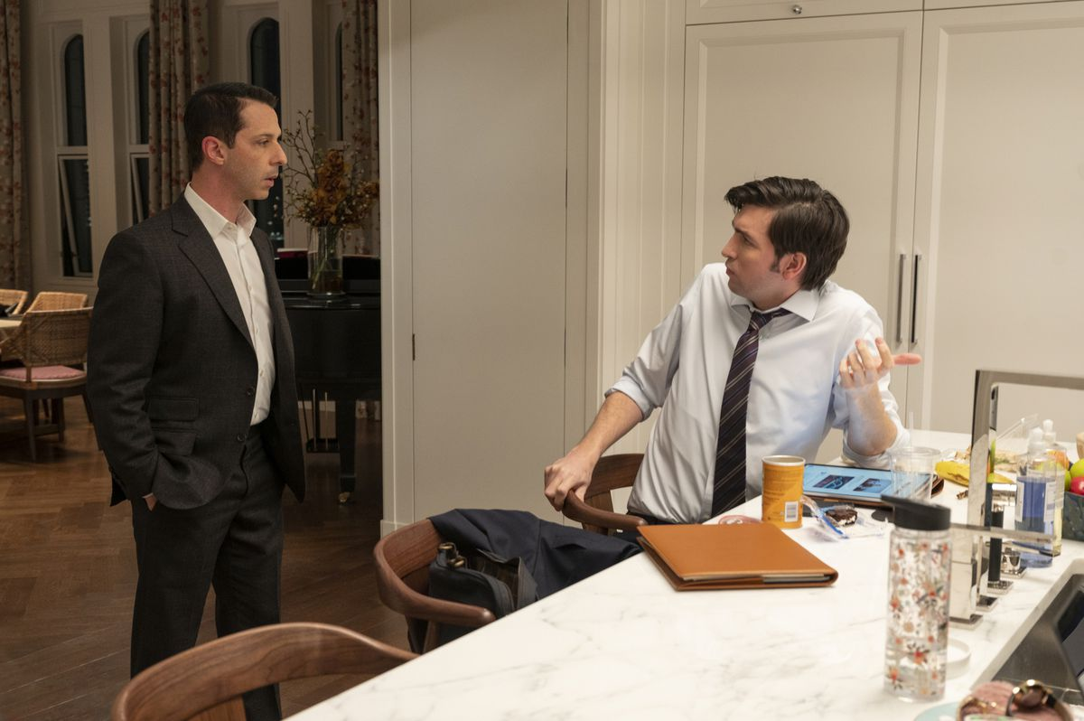 Kendall and Greg discuss their next moves in the kitchen of Kendall's ex-wife's apartment.
