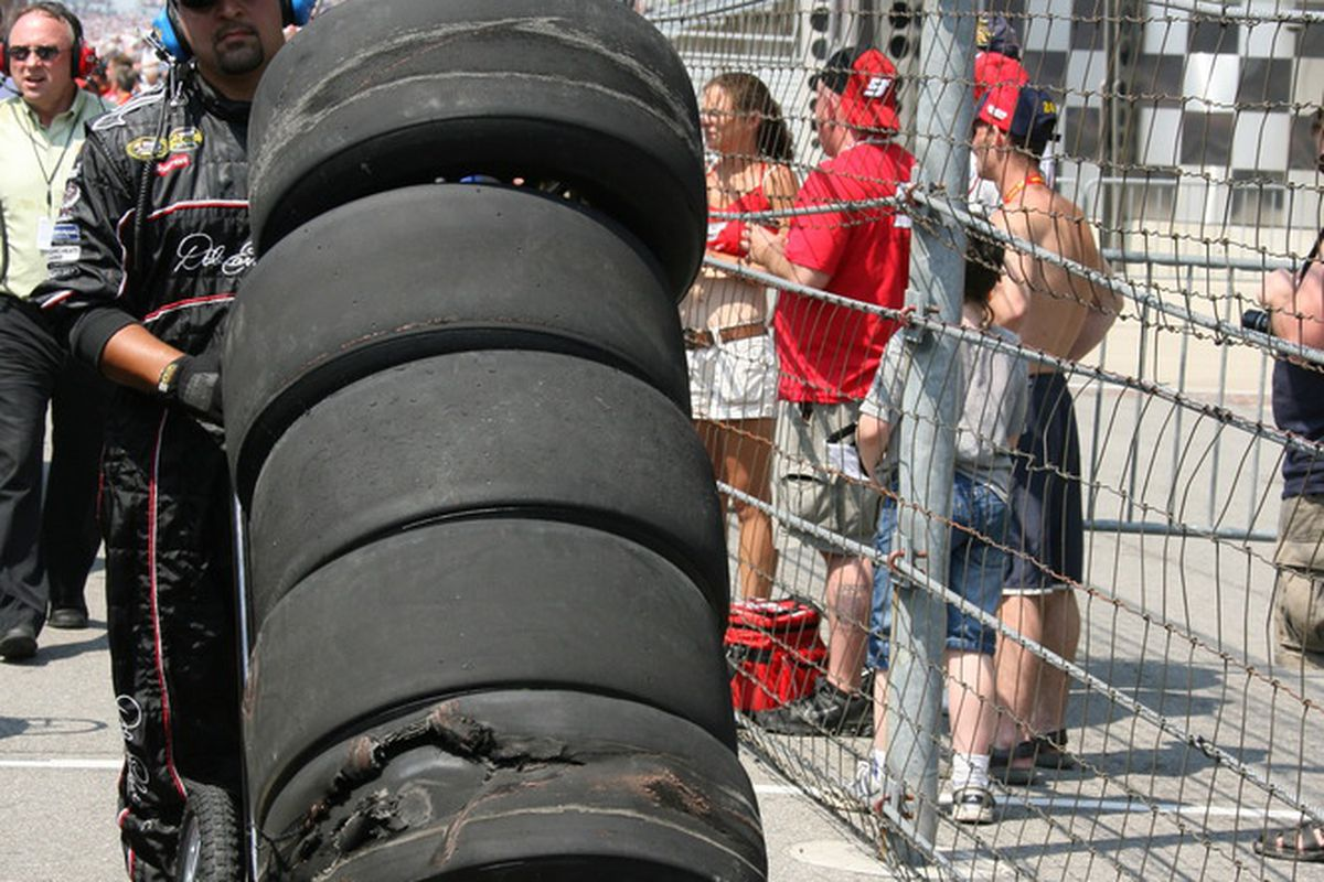 NASCAR crew members remove used Goodyear tires from the pit box during racing action at the 2008 Allstate 400 At The Brickyard. Tire issues plagued teams all day thanks to a new car and new tire compound. (Photo: Chris Jones/IMS)