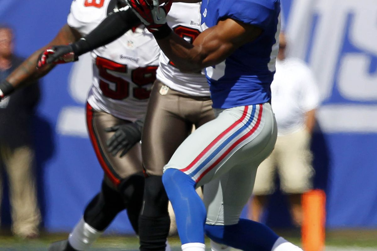 Sep 16, 2012; East Rutherford, NJ, USA;  New York Giants wide receiver Victor Cruz (80) makes reception against the Tampa Bay Buccaneers during the first half at MetLife Stadium. Mandatory Credit: Jim O'Connor-US PRESSWIRE