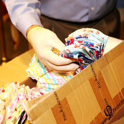 Rick Graham, vice chairman of the Pioneer Park Coalition, picks up a bundle of face masks at the Salt Lake County Sheriff's Office in South Salt Lake on Monday, May 11, 2020. The masks, which were made by members of Utah's Vietnamese community, will be given to inmates at the Salt Lake County Jail to help slow the spread of COVID-19.