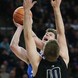 Brigham Young Cougars forward Dalton Nixon (33) drive son Utah State Aggies forward Quinn Taylor (10) in Logan on Saturday, Dec. 2, 2017.
