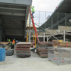1:30 p.m. Boards used for the left field concrete pouring awaiting reuse -