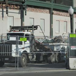 1:08 p.m. Debris from the concourse being brought out to the dumpster, in front of the ballpark -