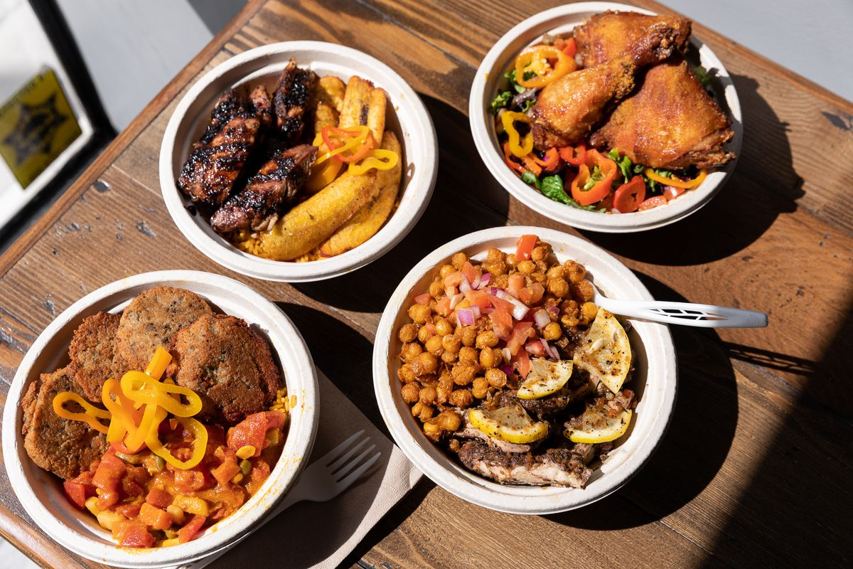 Bowls of Afro-Caribbean food including jerk chicken, fried ginger chickpeas, and suya fried chicken at Yum Village.