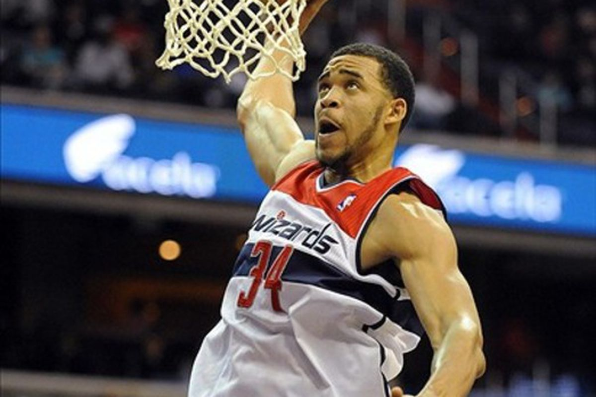 Mar 5, 2012; Washington, DC, USA; Washington Wizards center JaVale McGee (34) prepares to dunk the ball after being called for an offensive charging foul during the first half at the Verizon Center. Mandatory Credit: Brad Mills-US PRESSWIRE