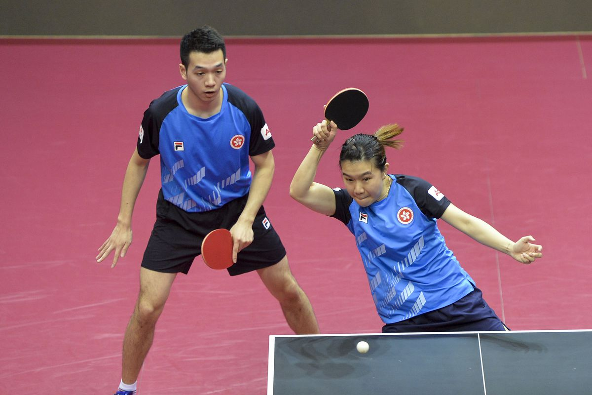 Ho Kwan Kit L/Lee Ho Ching of Hong Kong of China compete during the mixed doubles semifinal match against Mizutani Jun/Ito Mima of Japan at 2020 ITTF Qatar Open in Doha, Qatar on March 6, 2020.
