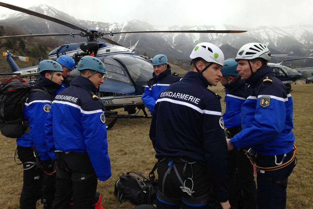 Rescue teams arrive near the crash site in the French Alps.