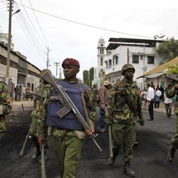 FILE - In this Friday, Aug. 31, 2012 file photo, a Kenyan Paramilitary soldiers patrol after they cleared the area of Muslim youths who were shouting slogans of 'Allah Akbar', God is Great, after the Friday prayers outside the Musa Mosque in the Majengo subburb of Mombasa Kenya, following riots in previous days. The government-funded Kenya National Commission on Human Rights said Wednesday, Sept. 26, 2012 that a proposed law to help fight the increased threat of terrorism would give the state sweeping powers that can be abused to intimidate political opponents.