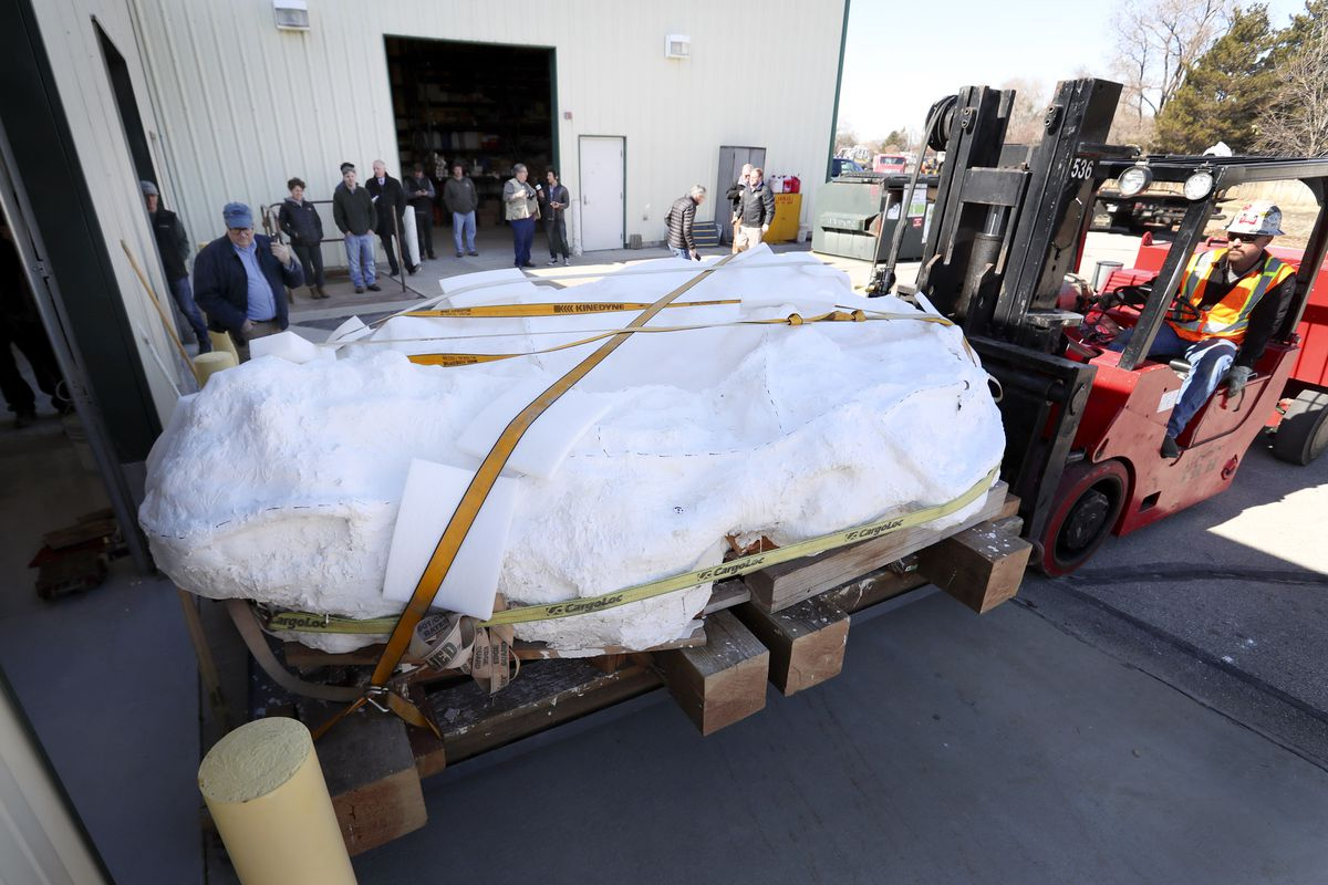 An 18,000-pound sandstone block full of dinosaur bones is moved into the Utah Department of Natural Resources' Utah Core Research Center in Salt Lake City on Wednesday, Feb. 26, 2020. Paleontologists say the block contains the best known preserved and most complete collection of Utahraptor skeletons ever found. It's believed the block contains the remains of at least six, and possibly more, Utahraptors, including one adult, four juveniles and one baby. Moving the block will allow Utah Geological Survey paleontologists, staff and university students to work more closely and frequently with the block to extract and prepare bones and fossils.