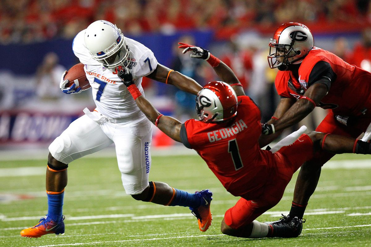 ATLANTA, GA - SEPTEMBER 03:  Branden Smith #1 of the Georgia Bulldogs is called for a facemask while tackling D.J. Harper #7 of the Boise State Broncos at Georgia Dome on September 3, 2011 in Atlanta, Georgia.  (Photo by Kevin C. Cox/Getty Images)