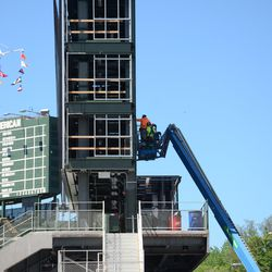 2:47 p.m. Working on the right-field video board -