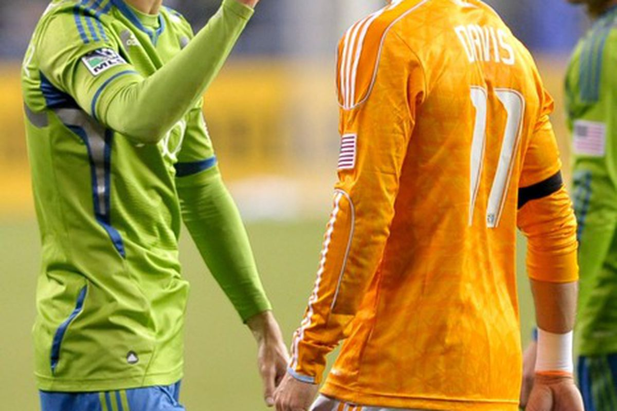 """It was a match that got a little chippy. Not just in play, but in the way the players related to each other. Here Alvaro Fernandez and Brad Davis exchange """"words."""" Mandatory Credit: Steven Bisig-US PRESSWIRE"""