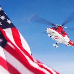 A Life Flight air ambulance lifts off after funeral services for Unified police officer Doug Barney at the Maverik Center in West Valley City on Monday, Jan. 25, 2016.