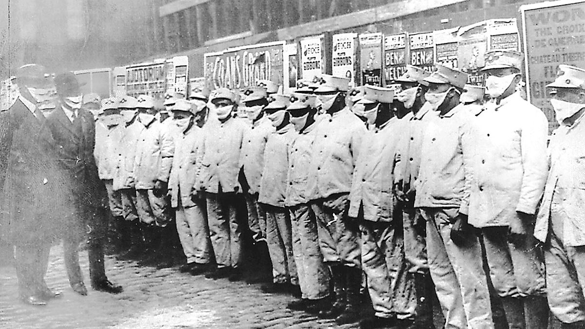 Masked Chicago sanitation workers are inspected by officials, also wearing masks, during the 1918 Spanish Influenza outbreak. The pandemic killed 8,510 people in Chicago in eight weeks