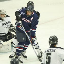 UConn's Shawn Pauly (9) watches the puck go in to the corner in front of the Providence goal.
