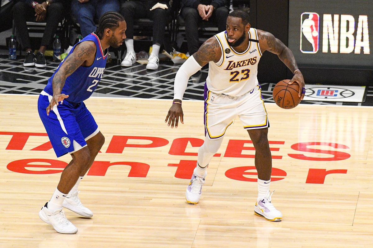 Los Angeles Lakers Forward LeBron James guarded by Los Angeles Clippers Forward Kawhi Leonard during a NBA game between the Los Angeles Lakers and the Los Angeles Clippers on March 8, 2020 at STAPLES Center in Los Angeles, CA.
