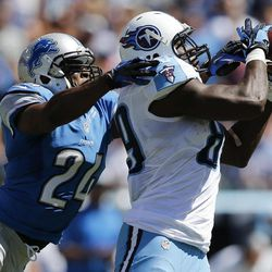Tennessee Titans tight end Jared Cook (89) catches a touchdown pass as he is defended by Detroit Lions strong safety Erik Coleman (24) in the second quarter of an NFL football game on Sunday, Sept. 23, 2012, in Nashville, Tenn.