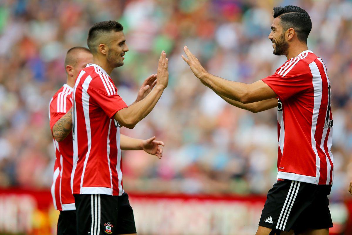 Tadić congratulates Pellè on scoring Southampton's third goal.