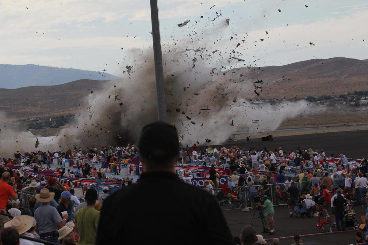 FILE - In this Sept. 16, 2011 file photo, A P-51 Mustang airplane crashes into the edge of the grandstands at the Reno Air show in Reno, Nev. The National Transportation Safety Board releases its safety recommendations Tuesday, April 10, 2012 for the Reno