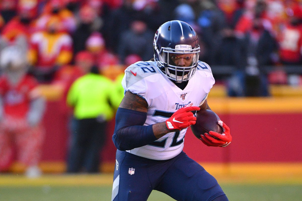 Tennessee Titans running back Derrick Henry runs the ball during the AFC Championship Game against the Kansas City Chiefs at Arrowhead Stadium.